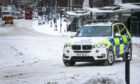 Police drive through Dundee's City Centre on Tuesday, February 9, 2021.