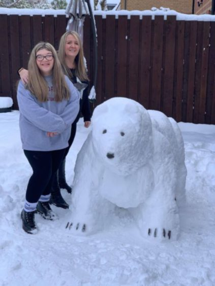 Kacey and Valerie Reid with their polar bear in Broughty Ferry.