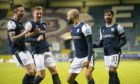Dundee players celebrate.