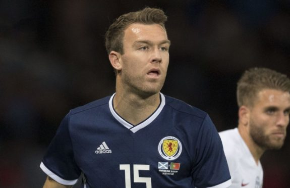 Kevin McDonald in action for Scotland against Portugal in 2018.