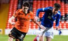 Dundee United right-back Liam Smith takes on St Johnstone's Callum Booth earlier in the season.