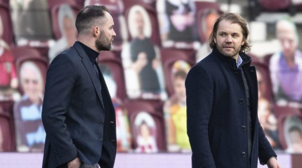 James McPake and Robbie Neilson have words.