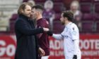 Dundee player Paul McMullan greets his former Dundee United boss and current Hearts gaffer Robbie Neilson.