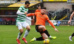 Dundee United midfielder Calum Butcher competes with Mohamed Elyounoussi for possession.