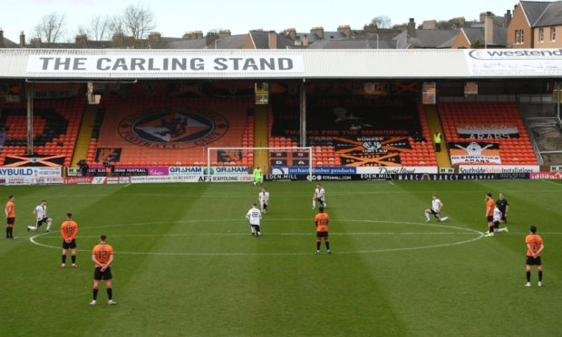 DUNDEE, SCOTLAND - MARCH 20: Dundee United Players make a stand against racism instead of taking a knee during the Scottish Premiership match between Dundee United and Aberdeen at Tannadice on March 20, 2021, in Dundee, Scotland. (Photo by Craig Foy / SNS Group)