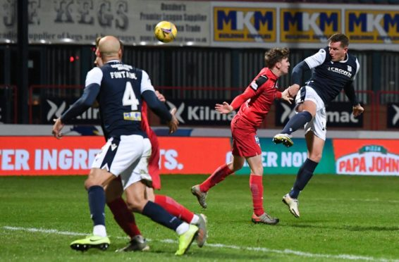 Lee Ashcroft heads home for Dundee against Dunfermline.
