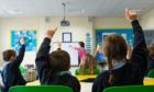 More than £3 million of money earmarked to improve the academic performance of disadvantaged children in Dundee has not been spent,