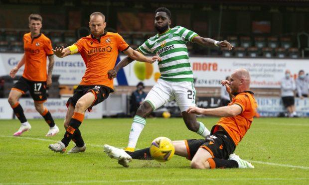 Dundee United skipper Mark Reynolds (second left) in action against Celtic back in August.