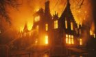 A previously unseen close-up photo of the height of the Morgan Academy fire on March 21 2001. Ed Thomson was one of the firefighters on the scene that night and took a series of unique photos, which he is sharing for the first time.