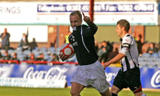 Leigh Griffiths celebrates scoring for Dundee.