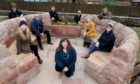 FOTRA chairwoman Morag Smith front) with those involved in the seating project.