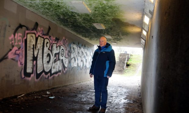 Kevin Keenan said the graffiti-covered under pass must be cleaned.
