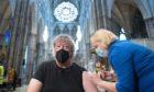 Stephen Fry receiving his vaccine.