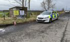 Police remain at the scene where the discovery was made.