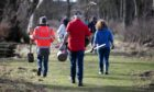 Volunteers taking part in tree planting at Hospitalfield House.