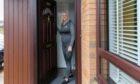 Karen Longmuir with her new front door