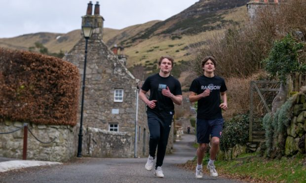 """Sam Allen and his 17 year old friend Euan Hardie who are """"climbing Everest"""" near their home in Kinneswood to raise cash to repair the crumbling Michael Bruce Cottage Museum."""