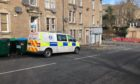 To go with story by James Simpson. Police reportedly at the scene in connection with the on-going murder investigation in Ardler. Picture shows; A police van on Main Street. Dundee. James Simpson/DCT Media Date; 10/03/2021