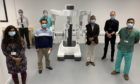 The new robot with staff at Ninewells Hospital