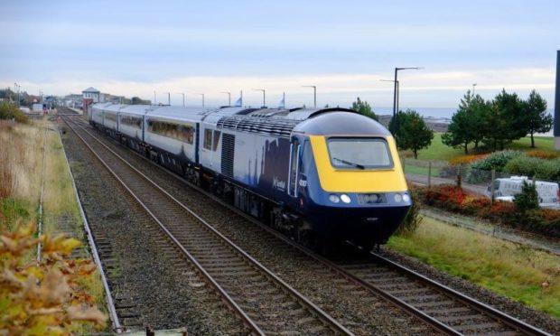A ScotRail train passing through Carnoustie.