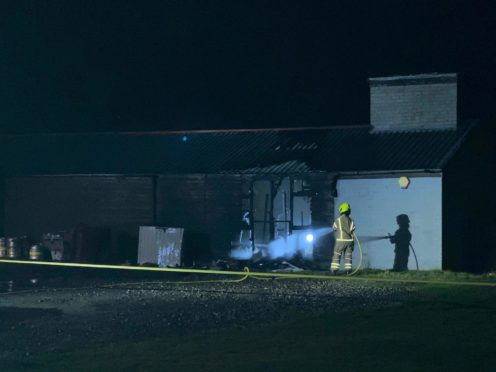 Fire crews extinguish the blaze at the Rosyth Sharks Rugby Club.