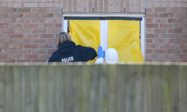 Forensics officers and police have been investigating at a property in Troon Avenue in Ardler.