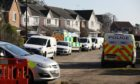 Police remain on the scene at Troon Avenue.