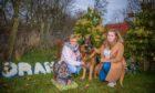 Belinda Robertson and daughter Joni Davidson with six-year-old German Shepherd, Boss.