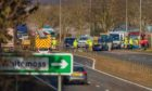 Emergency services at the scene of the crash near Auchterarder