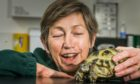 Barbara Barnard, with 17 year old tortoise, Mabel.