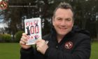 Micky Mellon with his book.