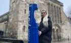 Local resident Claire Burns, 22, tries the top up tap in St Andrews.