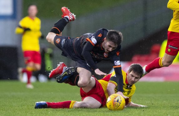Liam Smith of Dundee United is challenged by former Jag Steven Saunders in one of last season's Champions hipclashes.