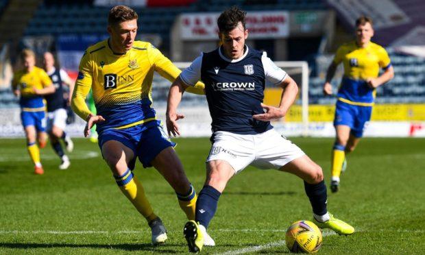 Dundee striker Danny Mullen shields the ball from St Johnstone defender Liam Gordon.
