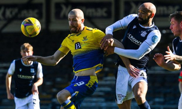 Dundee defender Liam Fontaine wrestles with St Johnstone right-back Shaun Rooney in their Scottish Cup clash at Dens on Saturday.