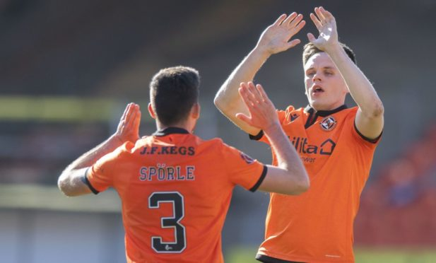 Dundee United striker Lawrence Shankland (right) celebrates his equaliser with Adrian Sporle.