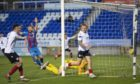Jason Cummings checks for a flag after seemingly opening the scoring at Inverness.