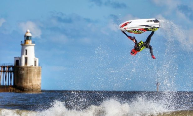 Ant Burgess practices his freestyle on a jet ski at Blyth beach in Northumberland, on the North East coast. Picture date: Saturday April 10, 2021. PA Photo. Photo credit should read: Owen Humphreys/PA Wire