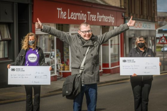 Connor Black with Avril Muir of Enable (left) and Morag McKenzie from the Learning Tree Partnership.