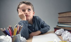 Is homework an unnecessary burden on younger schoolchildren and their families or is it essential to their education?