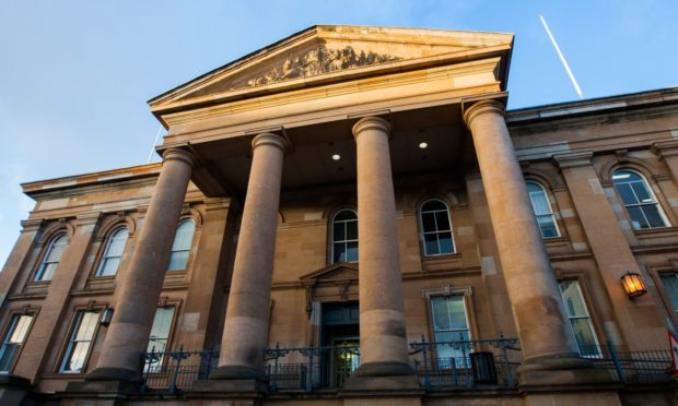 Wallace faces the charges at Dundee Sheriff Court