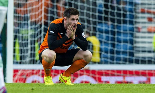 Dundee United midfielder Calum Butcher looks despondent after the Tangerines' League Cup Final defeat at the hands of Celtic in 2015.