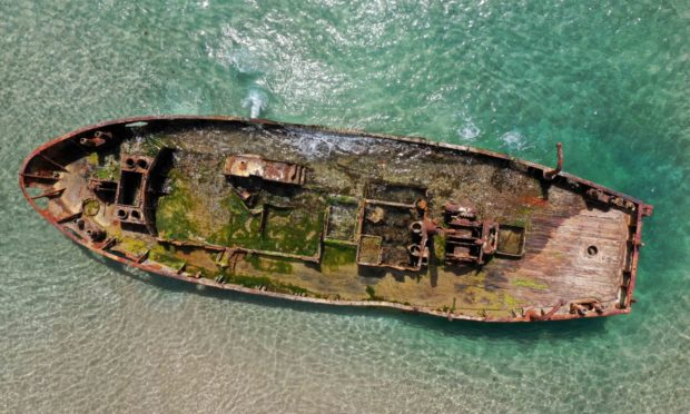 Mandatory Credit: Photo by Xinhua/Shutterstock (11891360a) Aerial photo taken on May 5, 2021 shows an abandoned boat in Dor HaBonim Beach Nature Reserve near northern Israeli city of Haifa. Israel Haifa Abandoned Boat - 05 May 2021