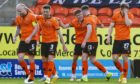 Dundee United celebrate Archie Meekison (centre) doubling their lead in the first half.