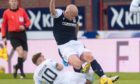 Rovers' Lewis Vaughan challenges Dundee's Charlie Adam.