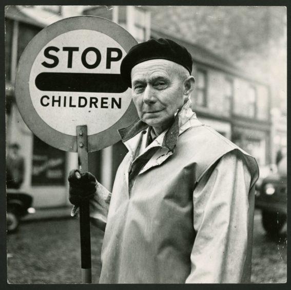 Crossing patroller William Joss at the Albert Street/Stobswell junction in 1969.