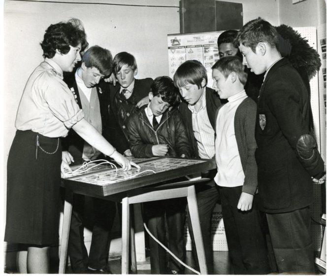 Policewoman Frances Fleming with pupils of Stobswell Boys' School at an exhibition in Lochee Road in 1968.