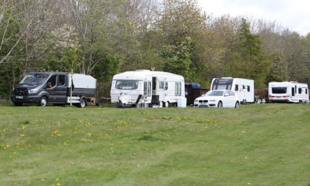 The caravans and vehicles parked up at the site.