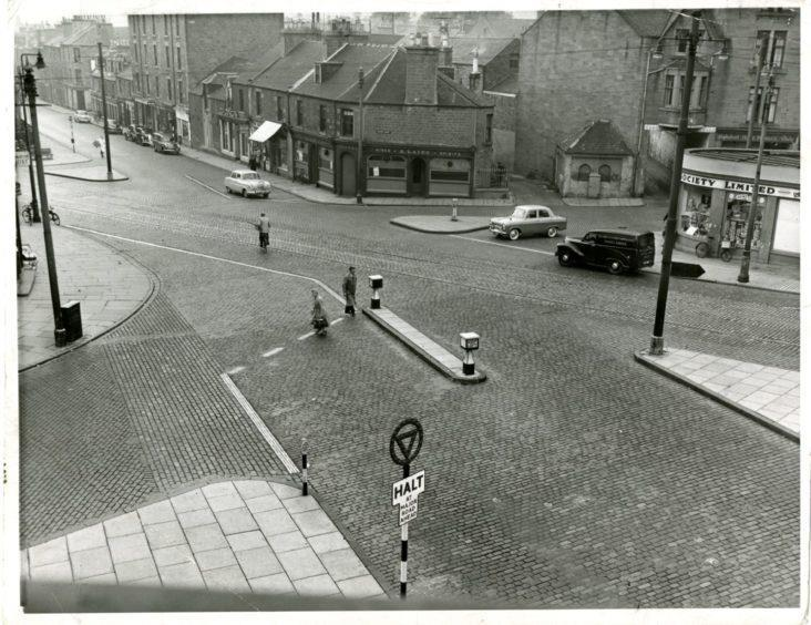 Stobswell crossing with a Halt sign in 1957.