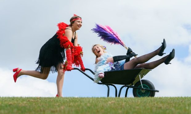 Jessica Fordham (left) and Fiona Fisk (right) take a trip back to the roaring 20s with fun flapper costumes ahead of the Harrogate Flower Show Spring Essentials at the Great Yorkshire Showground, as the event gets ready for the public ahead of further easing of lockdown restrictions in England. Picture date: Tuesday May 11, 2021. PA Photo. The North of England Horticultural Society (NEHS) is once again getting ready to sow the seeds of recovery with the 100th anniversary of its iconic flower show in Harrogate. Photo credit should read: Danny Lawson/PA Wire